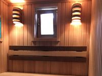 Баня из черной ольхи с печью Harvia в облицовке TALK